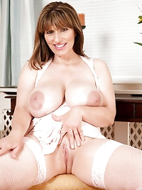 Busty milf spreads her pink pussy wide open on the table..