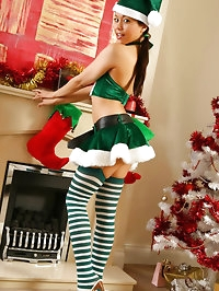 Naughty Lily S waiting Santa Claus presents by the..