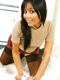 Raven haired beauty Lily S wearing a leather mini skirt..