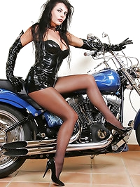Vixen poses on a motorcyle