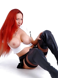 Kinky redhead with huge boobs shows off her assets wearing..