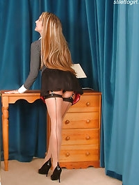 Sexy Secretary in black fully fashioned stockings & heels
