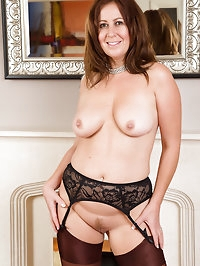 Elegant 47 year old Carol Foxwell slips out of her sily..