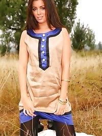 Cute brunette Natalia seductively removes gold dress..