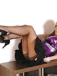 Hot blondes wearing tiny skirts and gorgeous black high..