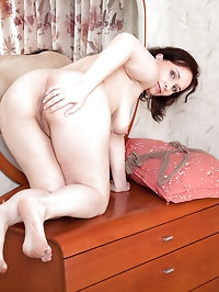 Thick granny stuffs with her landing strip pussy with a..