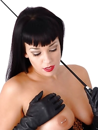 Busty femdom Sammi Jo has her tits out with her gloves on..