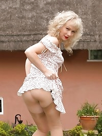 blonde toys in her layered nylons outdoors