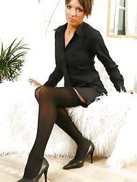 Beautiful brunette Yvette looking lovely in a dark office..