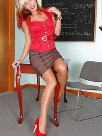 Sexy teacher in red heels and pantyhose