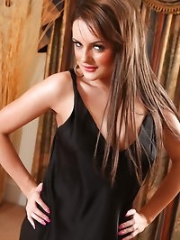 Katie T flaunts her perfect curves in her slinky black..