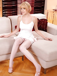 Innocent blonde teen in stockings