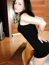 Petite 39 year old MILF Claudia K slips off her lacey..