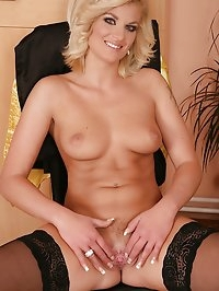 Mature babe Samantha Snow slips out of business skirt.