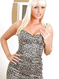 Perfect blonde slips out of her leopard print dress.