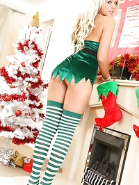 Delightful blonde slowly strips out of the Christmas..