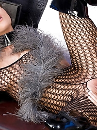 Two fetish babes in fishnet clothes playing