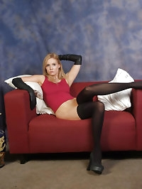 Sexy Lou puts on some black stockings and long leather..