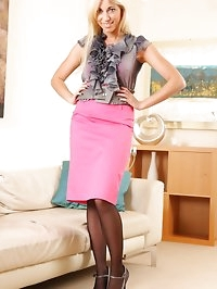 Bianca H strips from silk blouse to reveal pink stockings