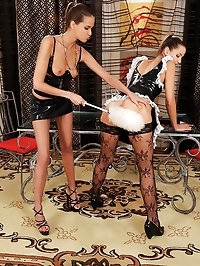 Latex mistress spanks French maid!