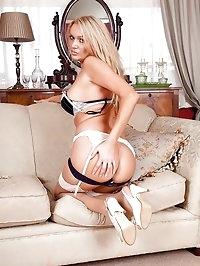 Stunning MILF Amber Jayne straddles panties between ankles.