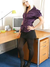 Stunning blonde in smart office outfit and dark pantyhose.