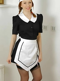 Sexy redhead Alex dressed in maids outfit with stockings