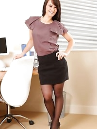 Amazing Emma looks stunning in the office in black pantyhose
