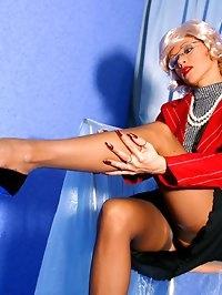 Kinky teacher shows long sexy legs in sheer nylons