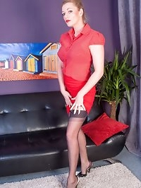 Holly dressed in black full fashion nylons, matching heels..