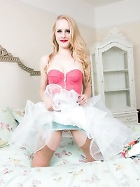 Lucy in a delightful floral full skirted dress, lacy..