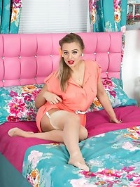 Beth in an uplifting set on the bed, stripping to her..