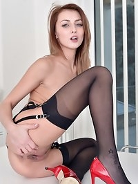 Bending over and slipping her panties down she exposes her..