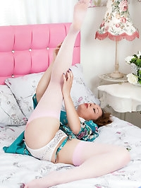 Sheer pink stockings encase Clair Adamss long legs as the..