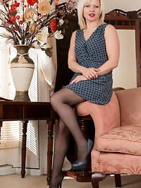34 year old milf Sophie May is looking hot in a dress with..