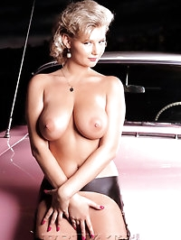 Rich bitch showing her big boobs in old car