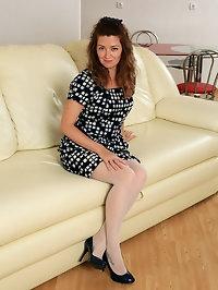 Helen Volga penetrates her hairy pussy