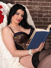 Stunning Sandra Nero enjoys a good book and masturbation