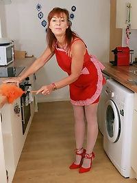 Horny housewife Georgie gets sexy in the kitchen