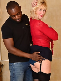 Blonde MILF Molly Maracas enjoys a steamy interracial..