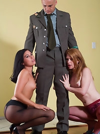 Two girls in pantyhose sharing the same dick in a threesome