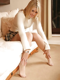 Poppy on sofa in white stockings