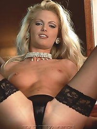 Rich elegant blonde babe in black stockings shows her pussy