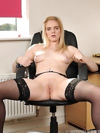 Cute blonde Carly Rae strips to her stockings in the office