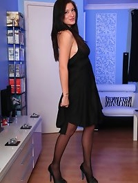 Brook in black dress, stockings and heels strips and spreads