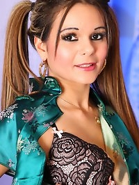 Chantelle peels off her silk cheongsam to play in her..