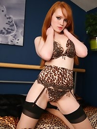 Charlie plays on the bed in leopard print lingerie and ff..