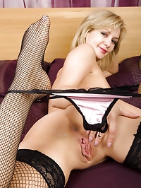 Hot blonde MILF Laurita showing off her black stockings in..