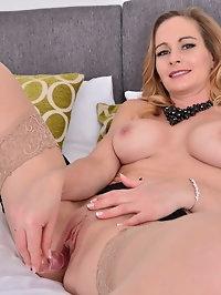 British hot MILF Elegant Eve fingering herself