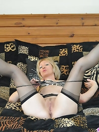 Penelope strips out of sexy lingerie